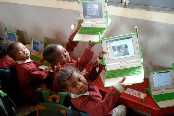 Children using OLPC's XO laptop